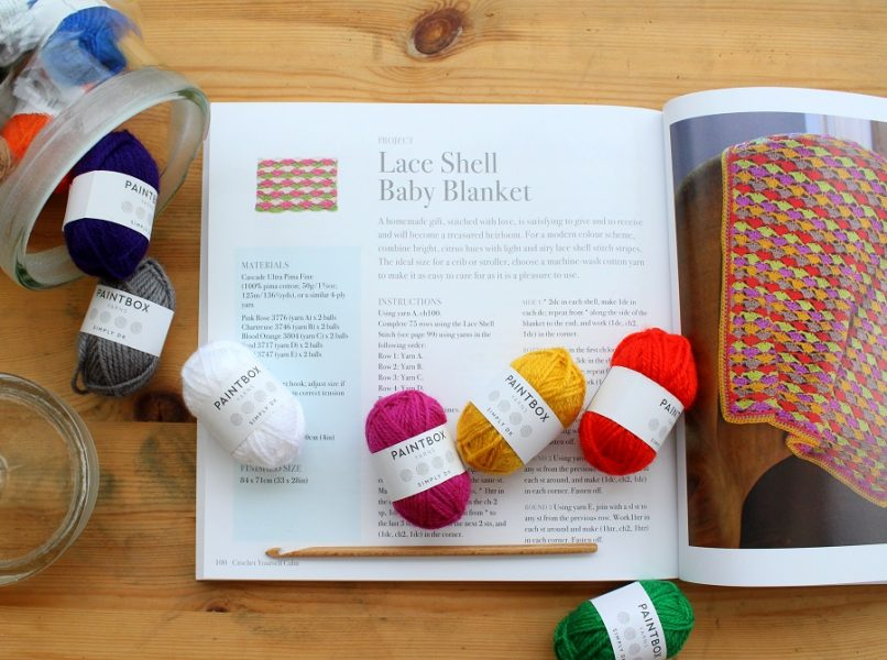 image of crochet yourself calm open book and yarn