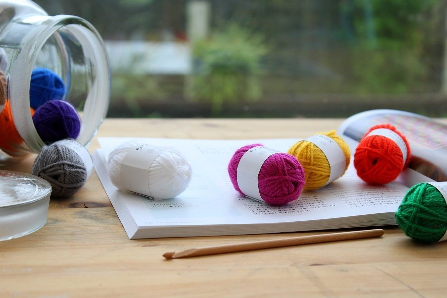 image of open crochet book and hook with yarn
