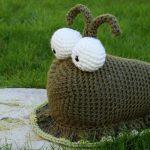 large crochet slug in the garden