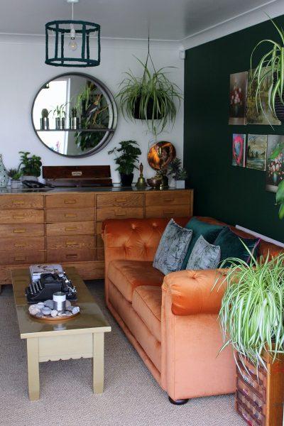 green wall orange velvet sofa