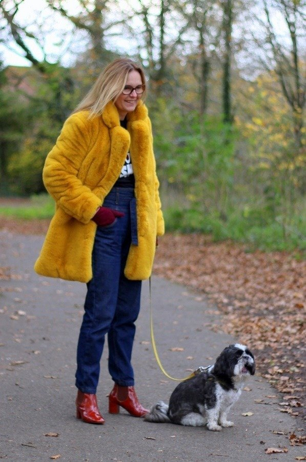 lazy daisy jones in faux fur with dog