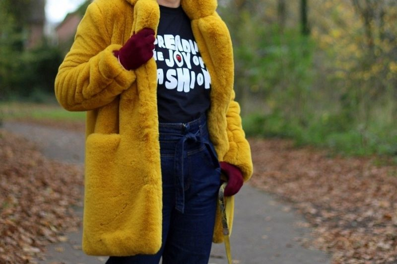 close up detail of yellow mustard faux fur coat