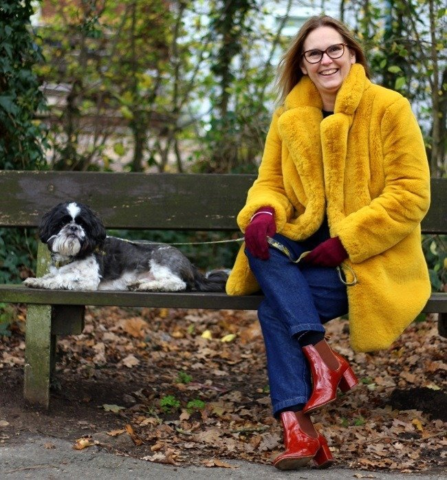 azy daisy jones wears yellow faux fur to take the dog out!
