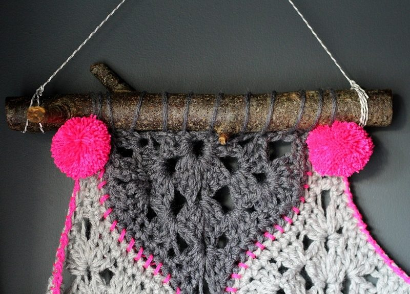 pompoms added to crochet wall hanging, tutorial on lazy daisy jones blog