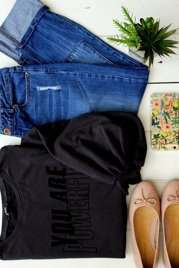 jeans sweatshirt and shoes laid flat casual outfit suggestion