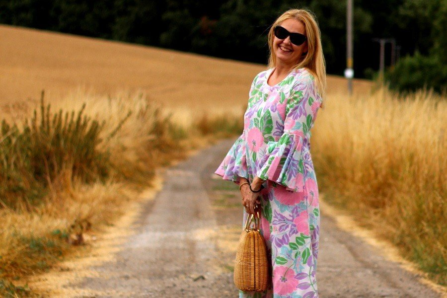 Vintage September wearing another pink dress in a Dorset field