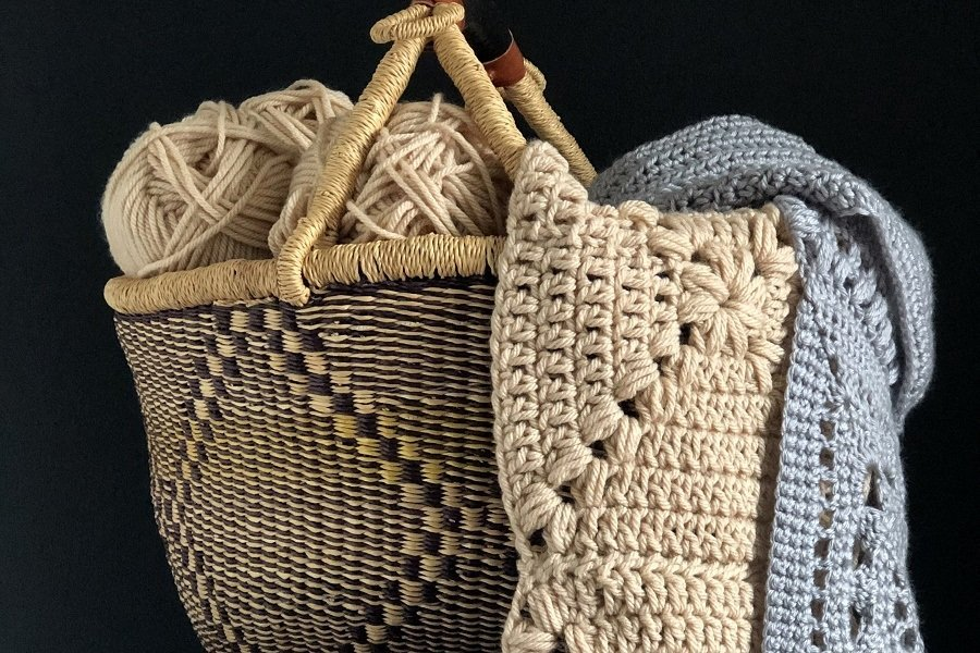 basket of yarn and crochet blankets!