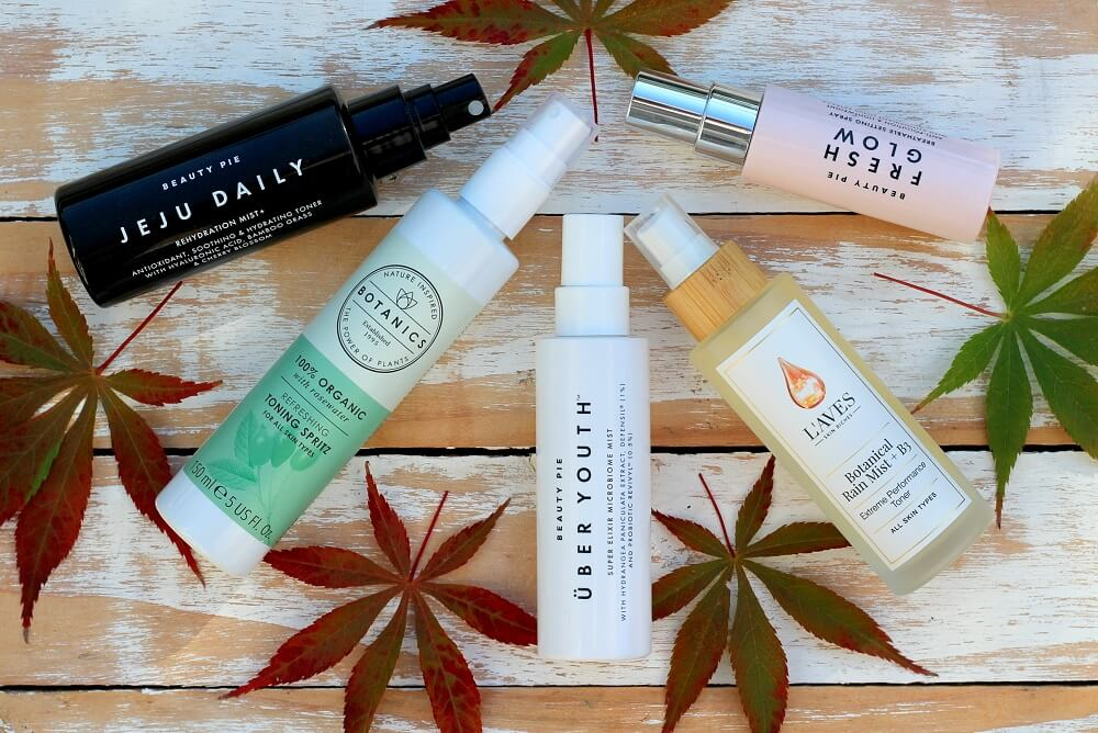 Flatlay 4 facial mists for skin hydration