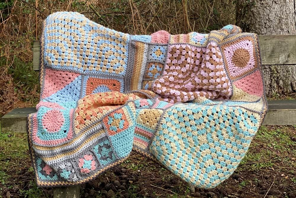 large crochet granny square blanket in the wilderness
