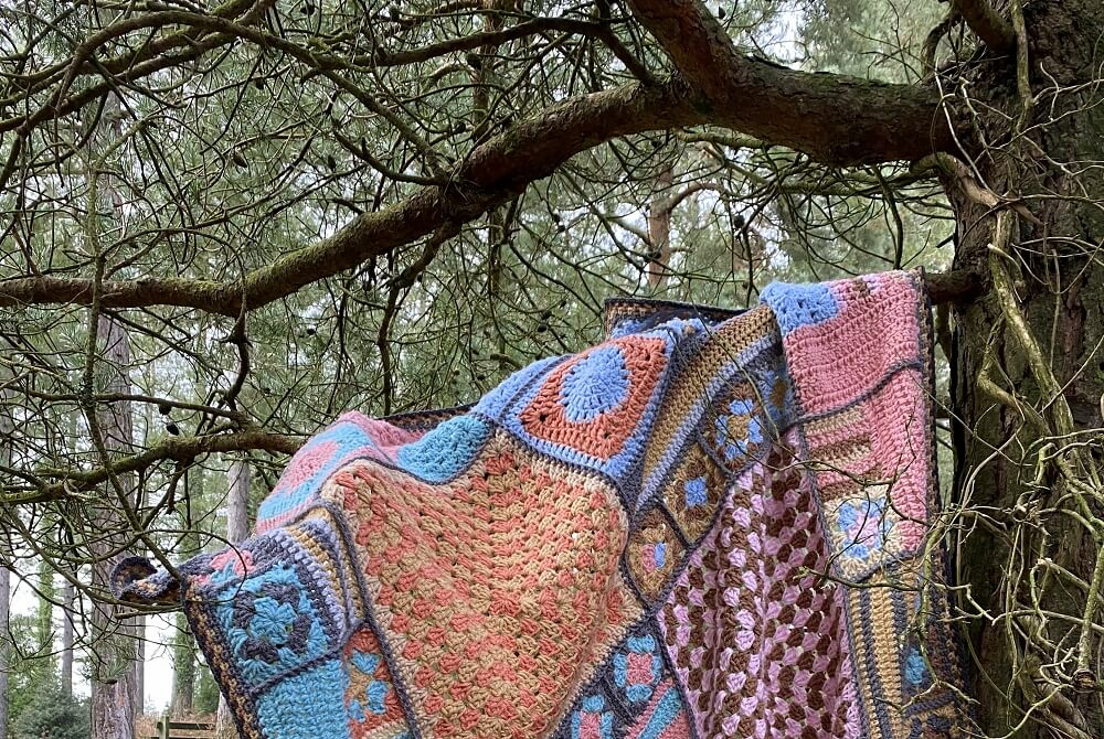 crochet granny square blanket in the wild woods