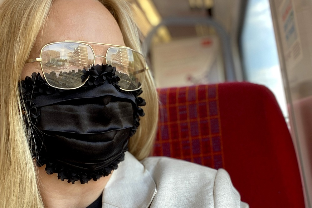 wearing a Vampires Wife silk mask on the train.